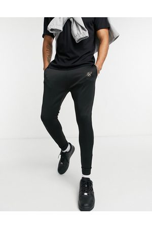 SikSilk Pants - Element muscle fit cuffed hem sweatpants in with gold logo detail