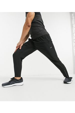 ASOS 4505 woven skinny tapered running sweatpants with reflective zip detail