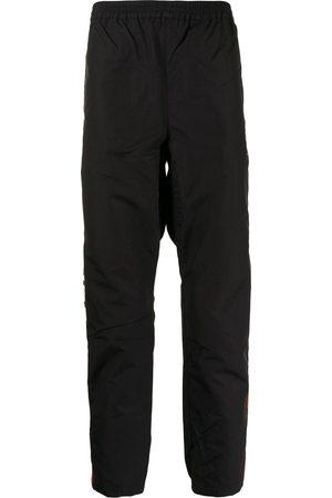 A Bathing Ape Camouflage-pattern track pants - BKB