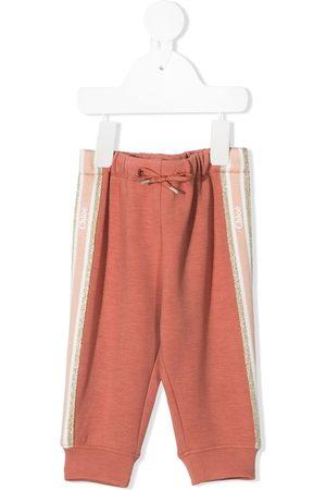 Chloé Chinos - Glitter logo stripe trousers