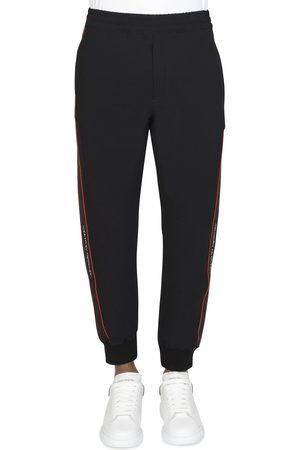 Alexander McQueen Men Sweatpants - Tape Logo Joggers