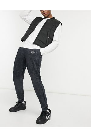 ASOS Coordinating tapered sweatpants in washed charcoal with rib cuff