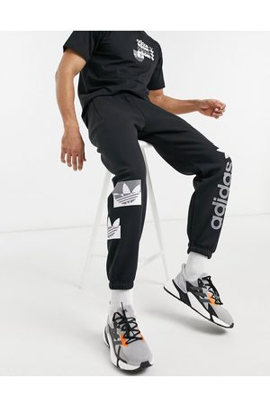 adidas Forum sweatpants in and pink
