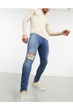 ASOS Spray on jeans with power stretch in vintage dark wash with rips-Blues