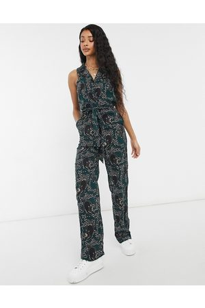 Monki Janelle belted sleeveless panther print jumpsuit in dark green-Multi