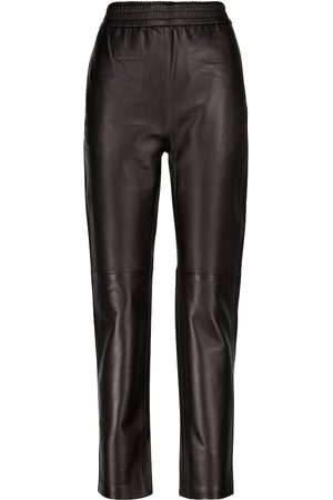 CO Essentials leather trackpants