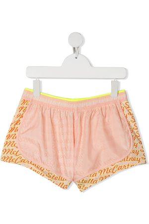 Stella McCartney TEEN logo pattern running shorts - Neutrals