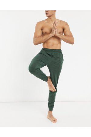 Nike Nike Yoga Hyperdry fleece sweatpants in khaki