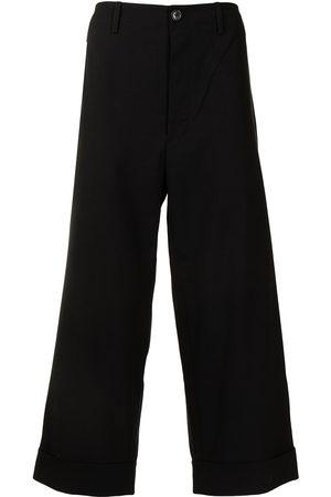 Ports V Slogan-print cropped trousers