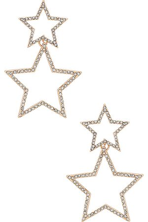 Ettika Star Drop Earrings in Metallic .