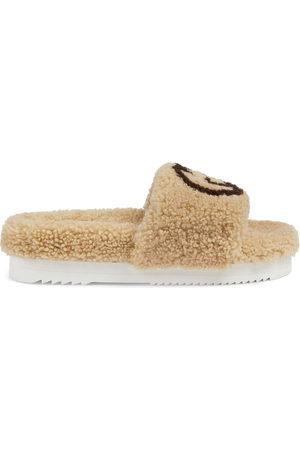 Gucci Women Sandals - Interlocking G shearling slides - Neutrals