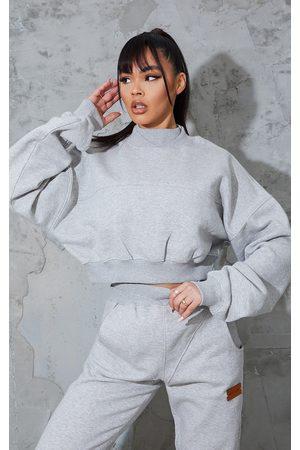 PRETTYLITTLETHING Grey Badge Back Detail Crop Sweater