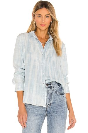 Bella Dahl Fray Hem Flowy Button Down Top in Blue.
