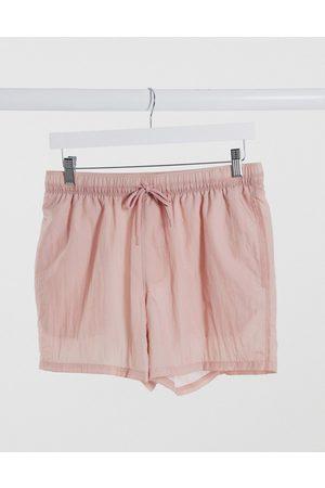 ASOS Swim shorts in sheer fabric with mesh underlay short length