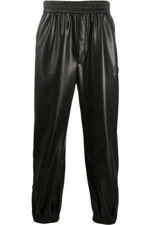 Nanushka Goro leather-look trousers