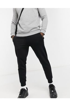 Guess Skinny cuffed sweatpants in with small logo