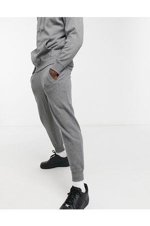 Guess Skinny cuffed sweatpants in with small logo-Grey