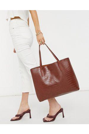 Claudia Canova Unlined A-line tote bag in tan croc
