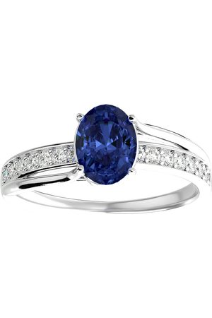SuperJeweler 1.5 Carat Oval Shape Tanzanite & 14 Diamond Ring in 14K (3.50 g)