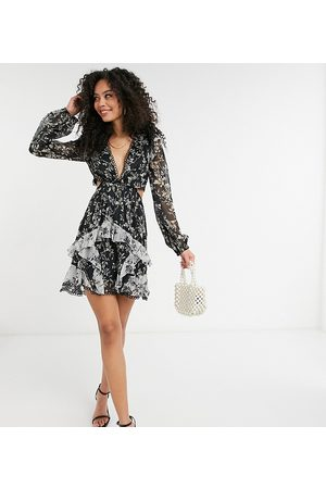 ASOS ASOS DESIGN Tall long sleeve mini dress in mixed floral print with circle trims in mono-Multi