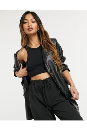 ASOS Leather look strong shoulder nipped waist longline blazer in