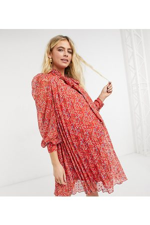 ASOS ASOS DESIGN Maternity pleated trapeze textured mini dress with neck tie in ditsy floral print