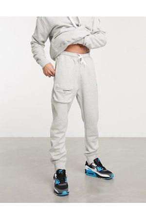 Nike Airmoji cuffed sweatpants in -Grey
