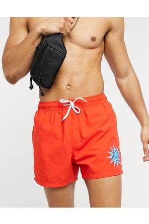 ASOS Swim shorts in short length with wellness print
