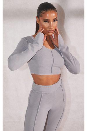 PRETTYLITTLETHING Women Crop Tops - RECYCLED Grey Marl Rib Raw Seam Split Hem Long Sleeve Crop Top