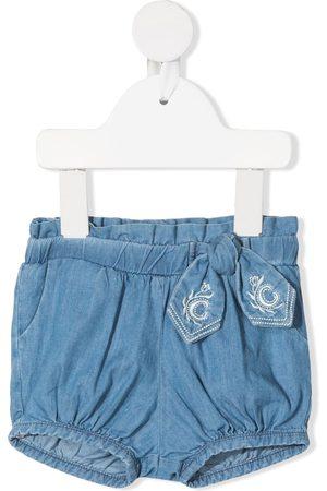 Chloé Bow-detail denim shorts