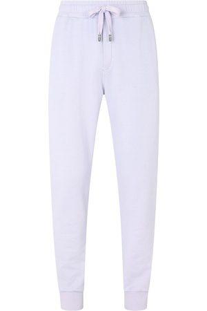 Dolce & Gabbana Tapered-leg cotton track pants - Neutrals