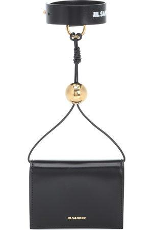Jil Sander Women Clutches - Band leather wallet