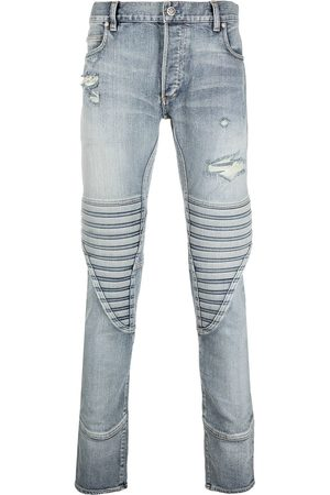 Balmain Distressed ribbed-panel skinny jeans