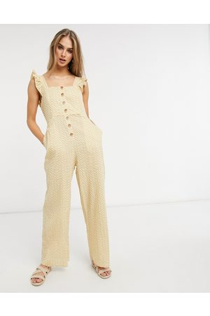 Fashion Union Exclusive beach button closure jumpsuit with ruffle detail in mustard wave print