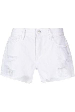 FRAME Ripped-detail cotton denim shorts