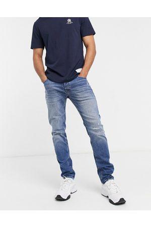 JACK & JONES Intelligence Glenn super stretch slim jeans with abrasions in midwash blue-Blues