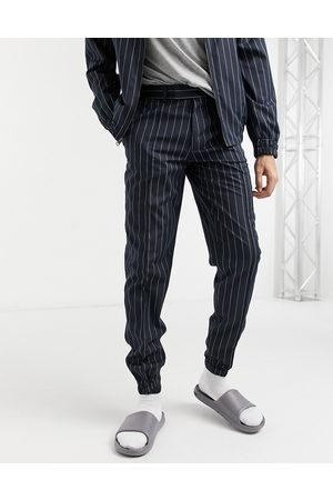 ASOS DESIGN Matching smart slim fit sweatpants in navy pinstripe