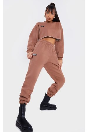 PRETTYLITTLETHING Mocha Washed Badge Detail Cuffed Joggers