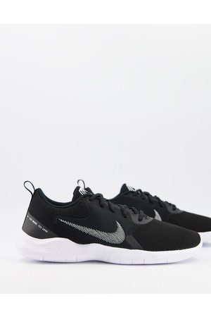 Nike Flex Experience Run 10 sneakers in black and