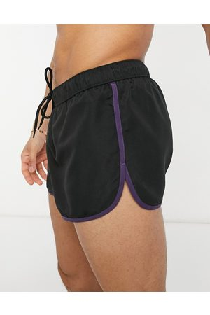 ASOS DESIGN Runner swim shorts in with contrast binding