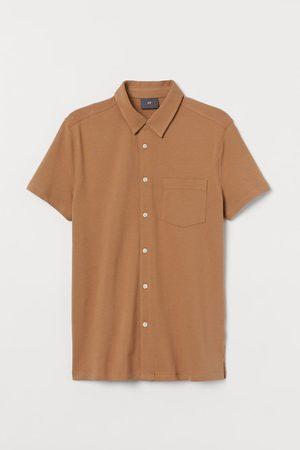 H&M Muscle Fit Piqué Shirt