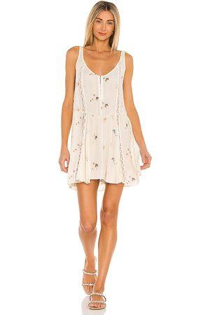 Free People Give A Little Mini Slip Dress in Ivory.