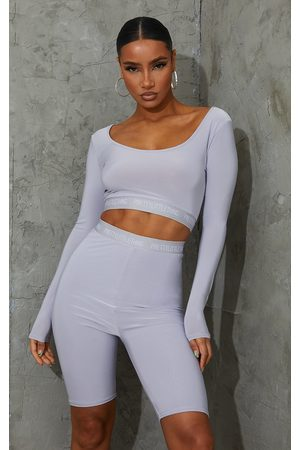 PRETTYLITTLETHING Grey Tape Slinky Long Sleeve Scoop Neck Crop Top