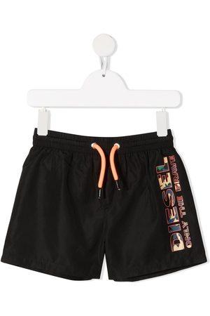Diesel Kids Camouflage-print logo swim shorts