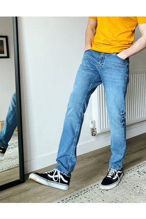 ASOS DESIGN Slim jeans in mid wash blue-Blues