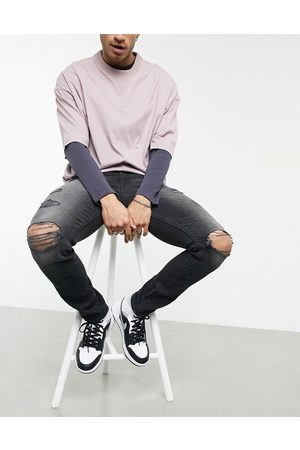 ASOS DESIGN Skinny jeans with 'less thirsty' wash in with heavy rips
