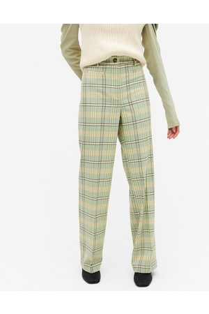 Monki Stacy check flared pants in green