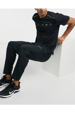 Nike Running Woven sweatpants in