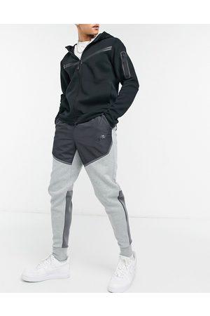 Nike Tech Fleece color block sweatpants in S23-Grey
