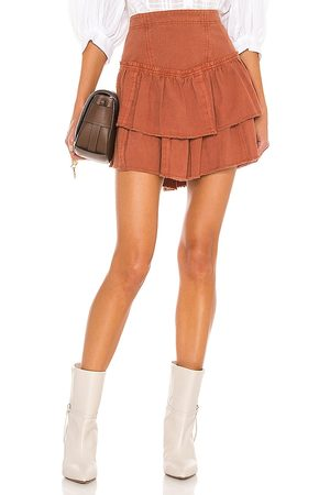 Free People Ruffles In The Sand Mini Skirt in Brick.